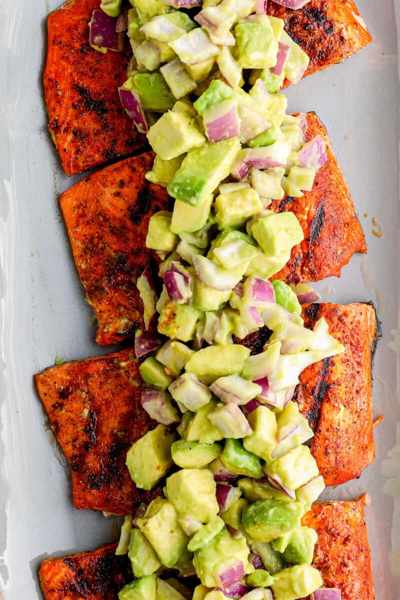 platter of grilled salmon with avocado salsa