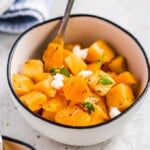 Baked Butternut Squash is such a simple side dish, but so delicious and healthy too. This maple-infused recipe is so sweet yet the broth balances it out perfectly. This maple roasted butternut squash recipe is easy to make, and you can also make a mashed version if you prefer. Pair it with your favorite main dish for dinner, or make this as the perfect Thanksgiving side dish!