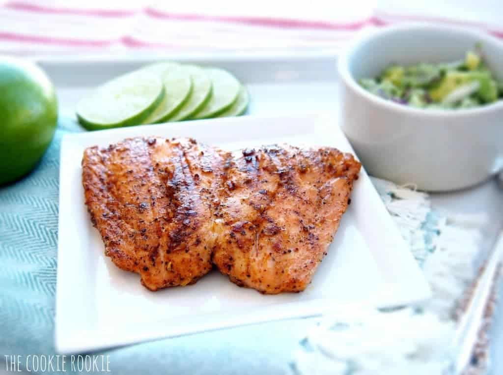 Grilled Salmon Recipe with Avocado Salsa (Healthy Whole30 Salmon Recipe!) is the BEST Salmon Recipe and just happens to be Whole30 approved! Spice rubbed Grilled Salmon topped with a creamy Avocado Salsa is one of the best Whole30 Recipes you'll ever try. Healthy, flavorful, EASY, and so delicious. Grilled Salmon with Avocado Salsa is a flavor match made in Heaven.