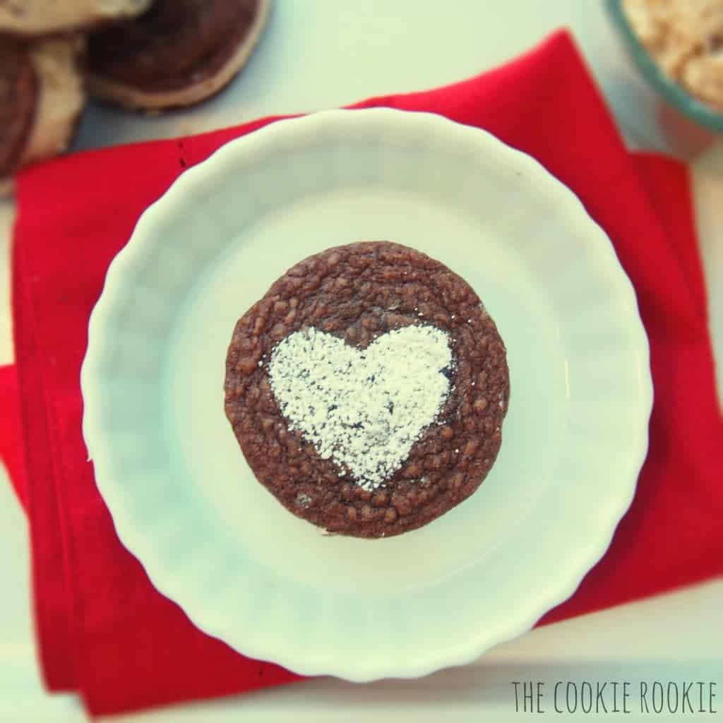 brownie whoopie pies made with reeses peanut butter cup filling. AMAZING.