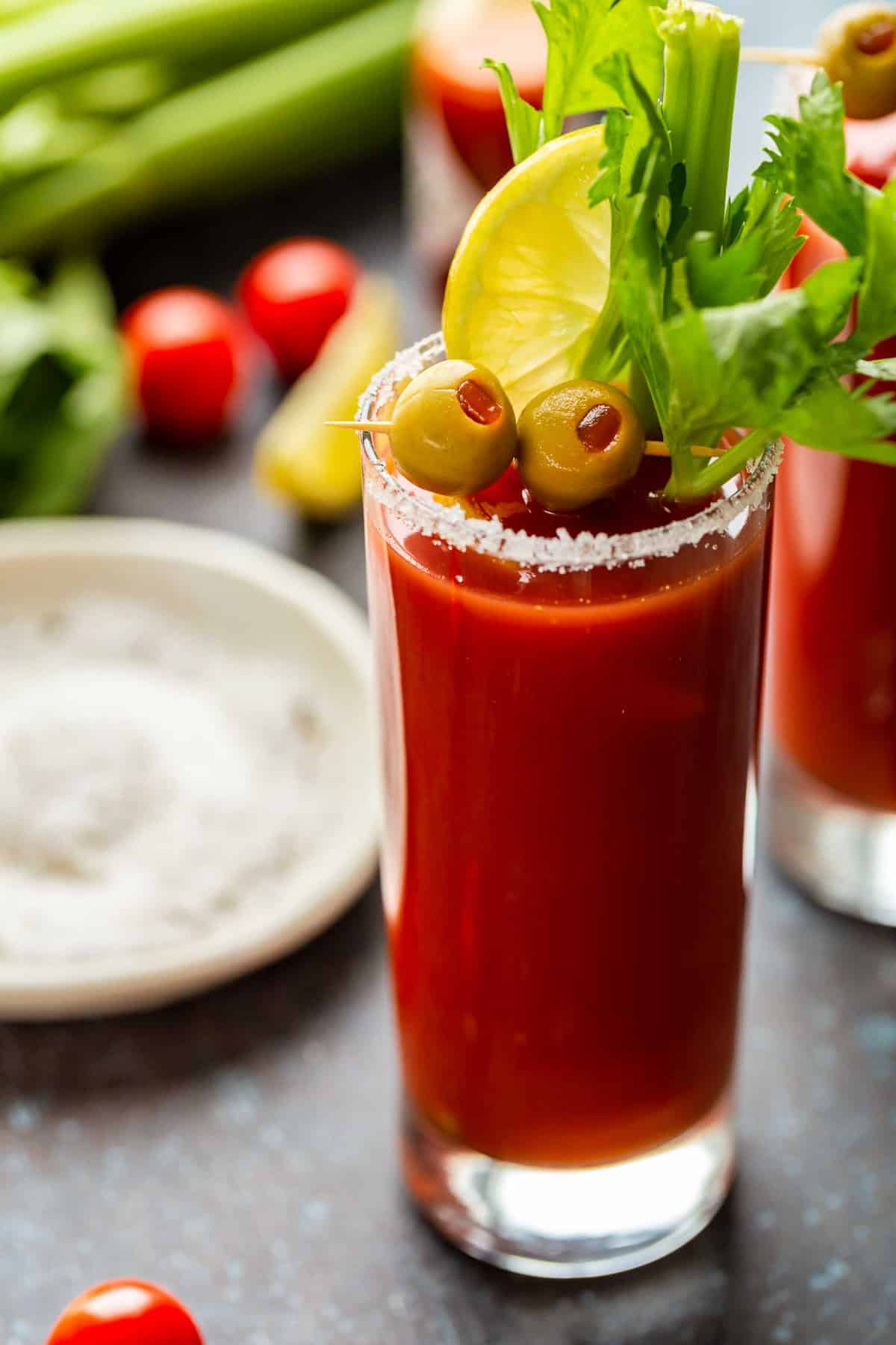Bloody Mary garnished with olives and celery
