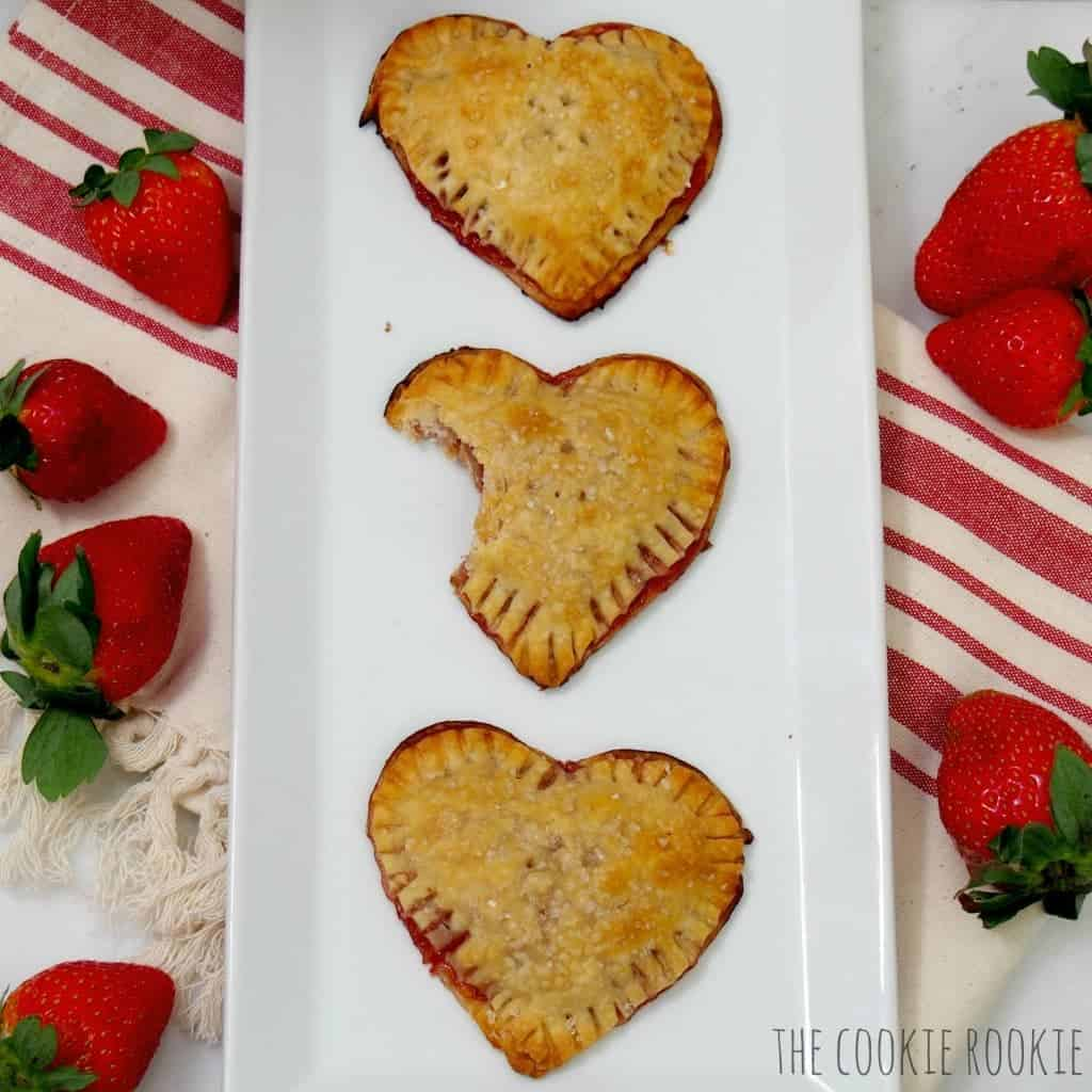 i heart strawberry hand tarts! the filling is infused with Grand Marnier! #traderjoe #valentine #strawberry #tart