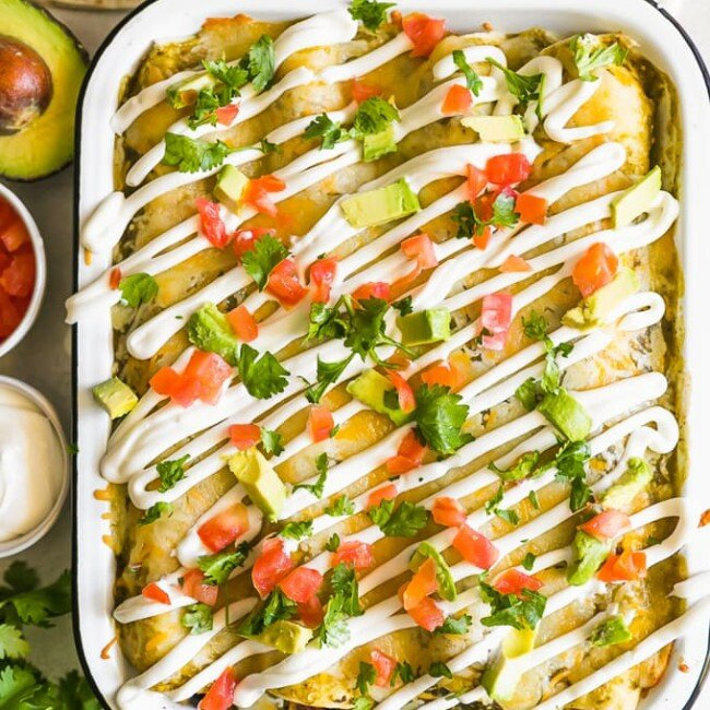 sweet potato enchiladas with chicken in a white dish