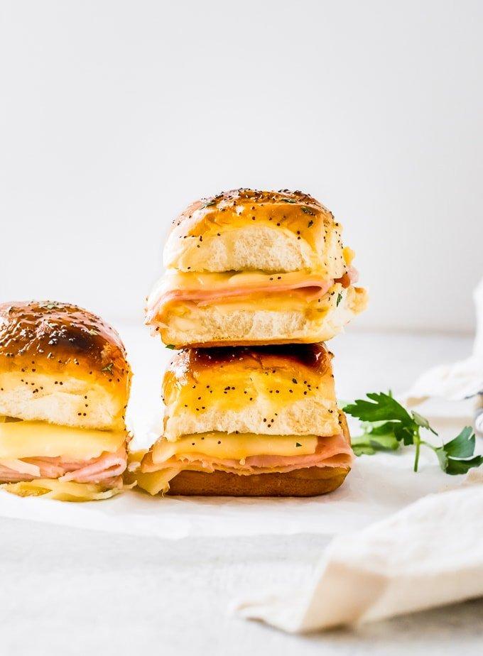 ham and swiss cheese sliders stacked on each other