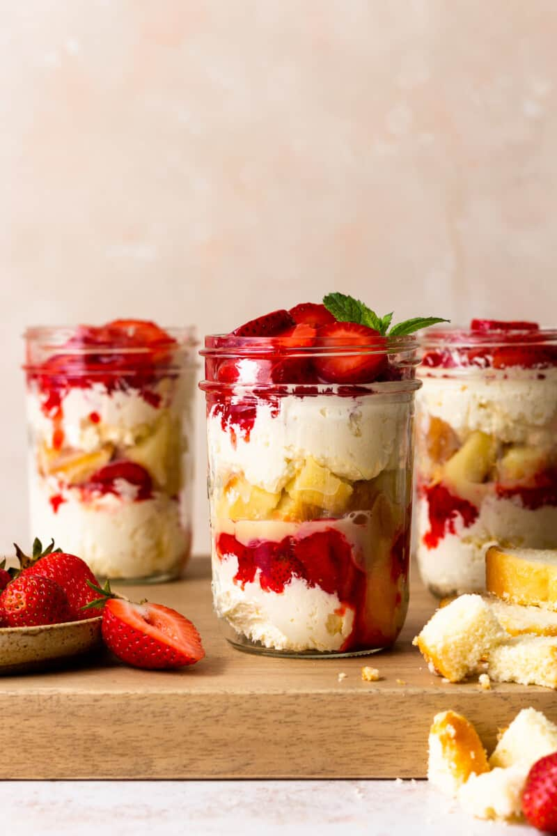 three jars of strawberry shortcake in cups
