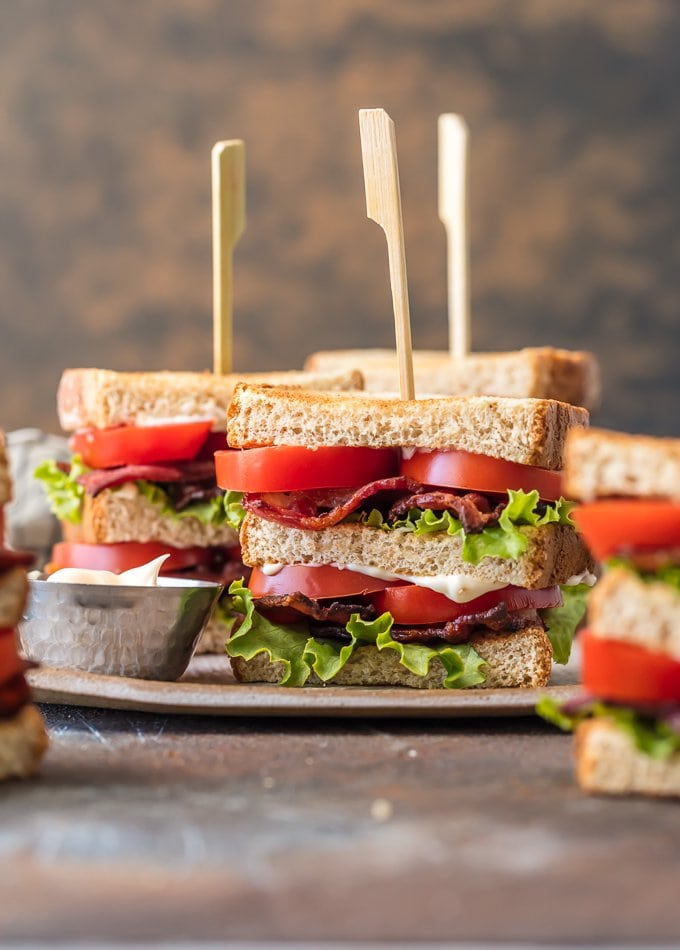 BLT Sandwich Sliders are a delicious and classic lunch or dinner recipe for any occasion, especially Summer celebrations! This smaller version of a Classic BLT Recipe, layered with crispy bacon, fresh lettuce, and juicy tomato, is utterly delicious and fool-proof. Cut the bread into fourths for an appetizer or in half for a perfect sharable main course.