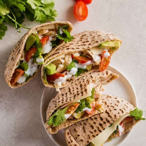 Chicken Pita Sandwiches are a healthy and delicious lunch option. This Chicken Avocado Sandwich is perfect for work days. Easy to make and so much flavor! These Chicken Avocado Pita Pockets prove that healthy lunches don't have to taste boring.