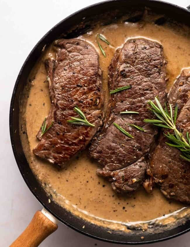 garlic rosemary steak in a skillet