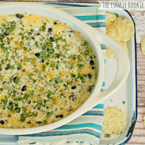 Smokey Southwest 3-Cheese Dip. BEST DIP EVER! Corn, beans, cilantro, and cheese. YUM! - The Cookie Rookie