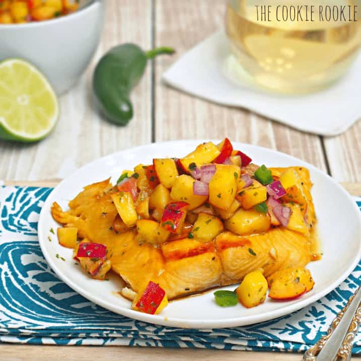 a plate of grilled salmon topped with peach salsa