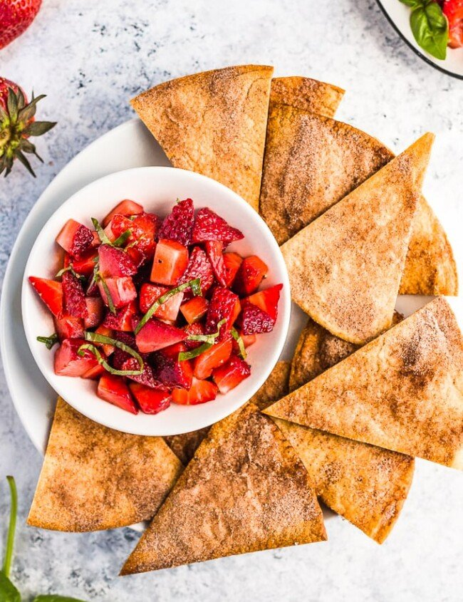 Strawberry Salsa with Cinnamon Tortilla Chips is a fresh & simple summer appetizer. This easy fruit salsa recipe pairs perfectly with homemade cinnamon sugar tortilla chips!