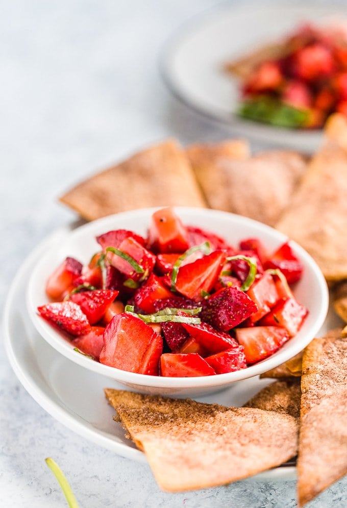 A bowl of strawberry salsa with basil