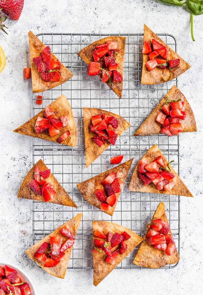 Cinnamon sugar tortilla chips topped with strawberry salsa, on a baking rack