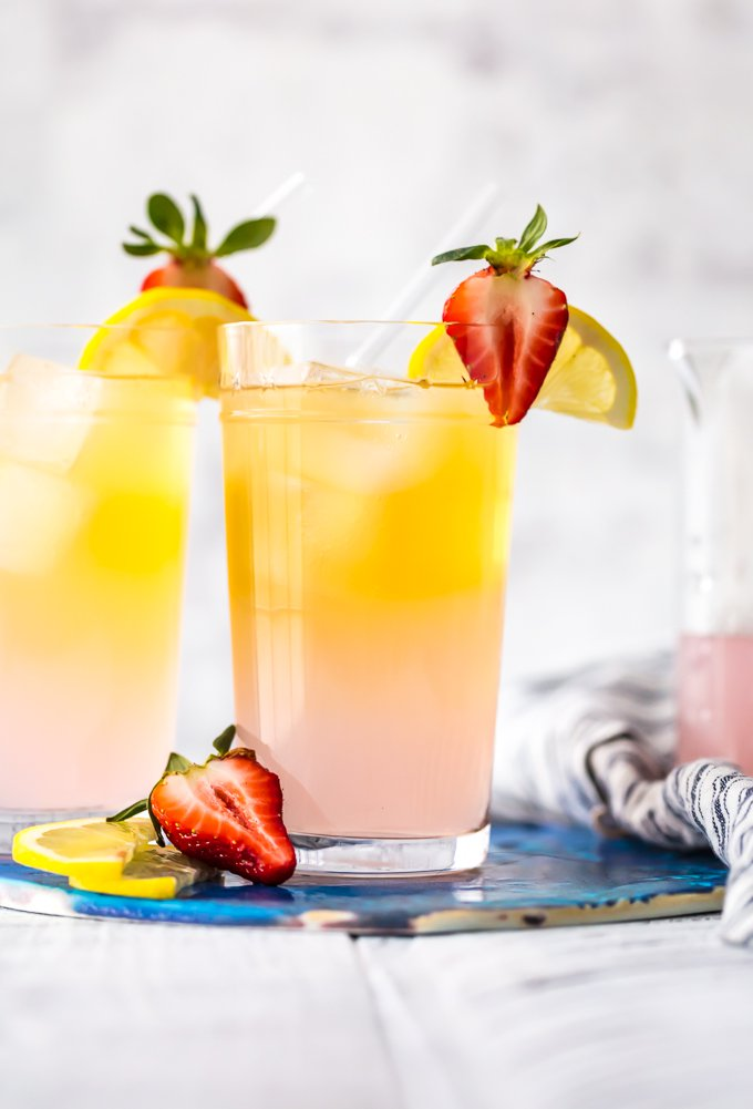 summer shandy topped with strawberries and lemon