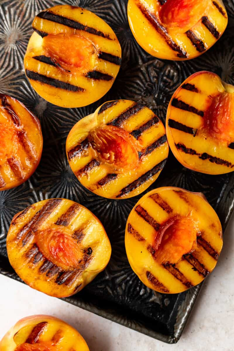grilled peaches on baking sheet