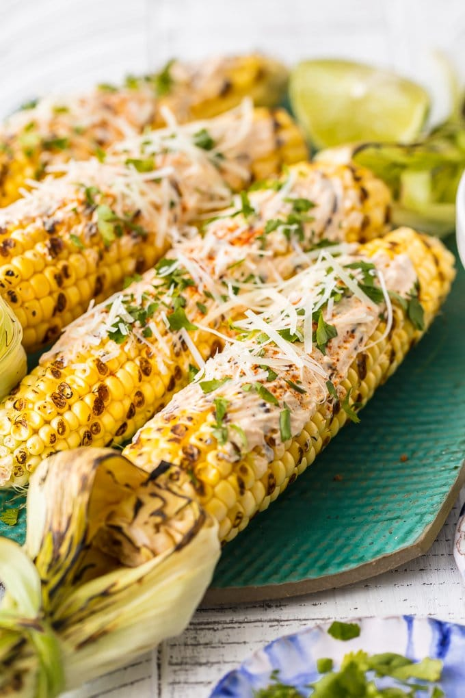 mexican corn grilled and topped with cheese, cilantro, mayo, and more