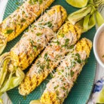 Mexican Corn on the Cobis the perfect Summer side dish! We love to make this Mexican Grilled Cornand serve it all Summer long. This Mexican Corn on the Cobis so easy, unique, flavorful and delicious! We have made our recipe for Mexican Corn healthy, simple, and perfect for every occasion.