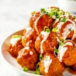 Buffalo Chicken Meatballs are one of our very favorite party appetizers. These Blue Cheese Stuffed Meatballs are relatively healthy, SO flavorful, and sure to please. If you're not sure what to serve for your next tailgating party, this Buffalo Chicken Meatballs Recipe is just the thing. Serve with Homemade Ranch!