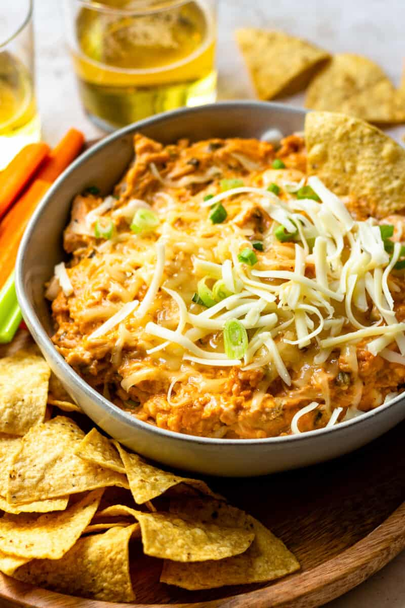 crockpot bbq chicken dip in gray bowl with cheese