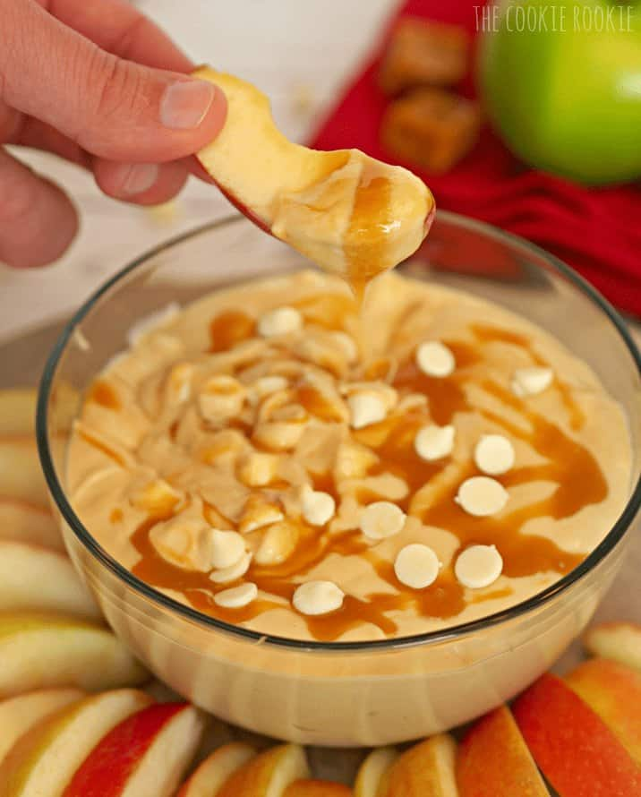 A bowl of food on a table, with Apple and Caramel