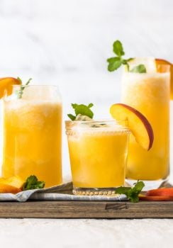 Peach Lemonade is our go-to summer drink! This easy peach drink is made with only 2 ingredients, both frozen so you can make this icy cold drink in minutes. This recipe can be served non-alcoholic to share with everyone, or you can turn it into a delicious peach cocktail with just a bit of vodka. This refreshing drink was just made for Summer. I'm in love!