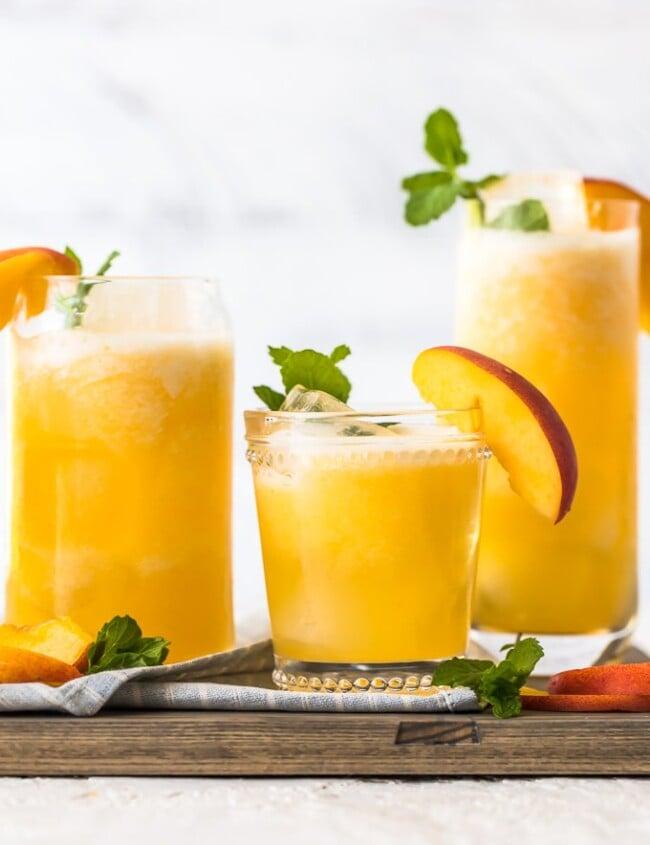 Peach Lemonade on a wooden platter