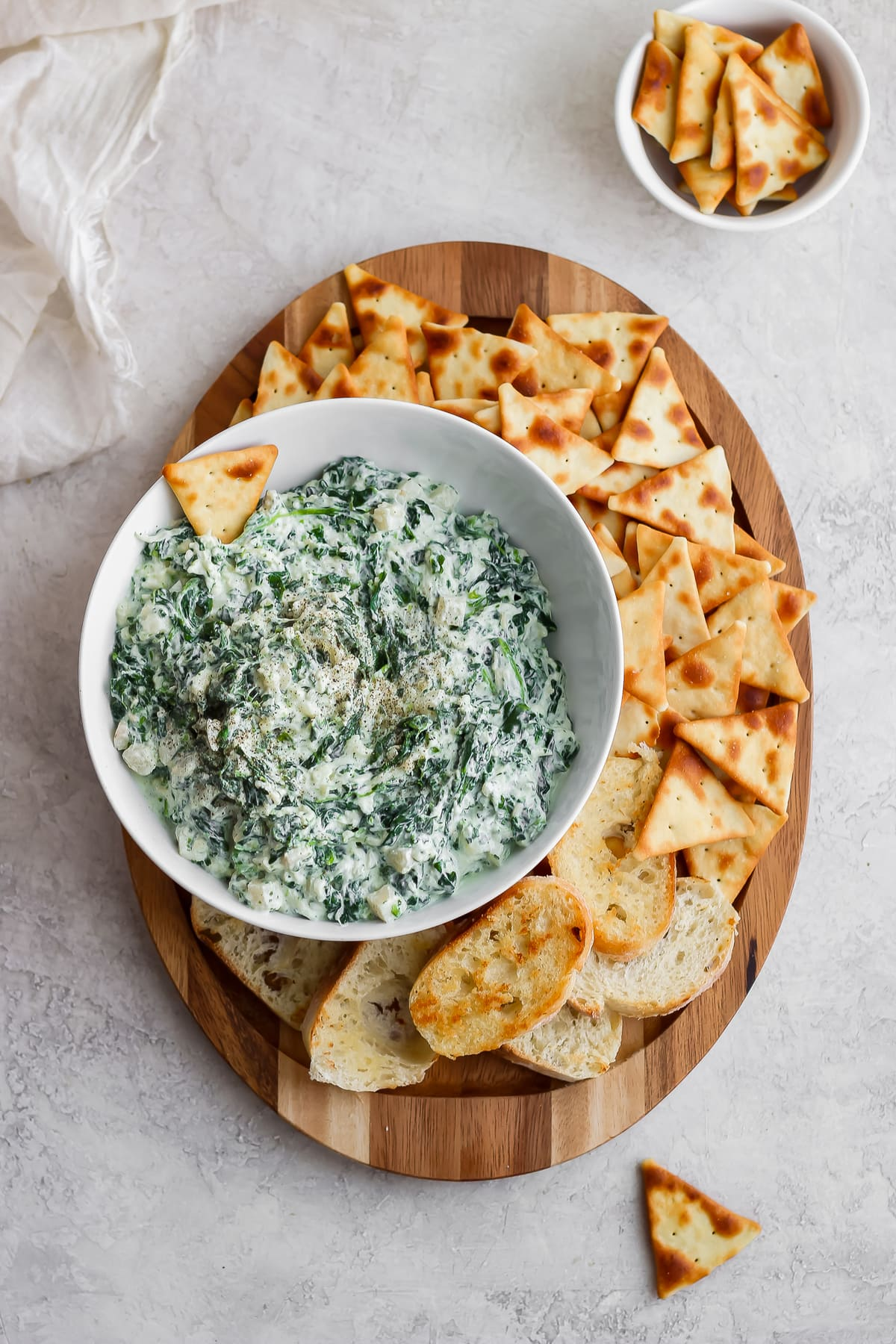 serving platter of pita chips and healthy spinach dip