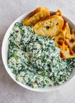 Crockpot Skinny Parmesan Spinach Dip is a delicious and healthy(er) way to enjoy your next tailgate! The perfect appetizer! So fun to not have to feel bad about this classic recipe!