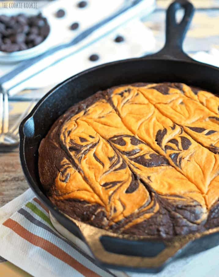 skillet brownie topped with pumpkin pie layer
