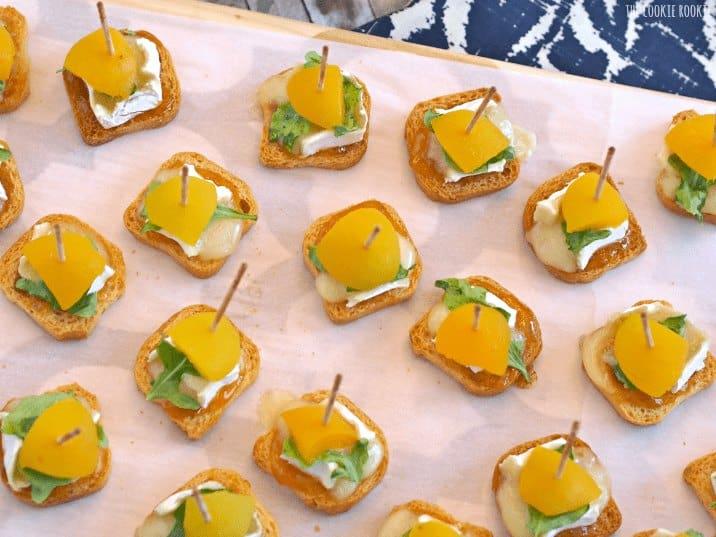mini apricot brie bites on white tray