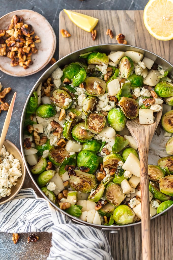 This Brussels Sprouts Recipe with Pears, Blue Cheese, and Walnuts Pear and Blue Cheese Roasted Brussels Sprouts is our favorite way to dress up a healthy side dish. These Brussels Sprouts are unique and so full of flavor. The pear pairs (ha!) beautifully with the blue cheese and toasted walnuts, making sure even the pickiest eater want to eat their greens. Such a great holiday side dish!