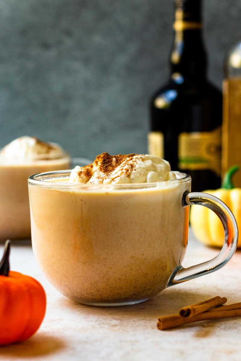 hot pumpkin cocktail in mug with whipped cream