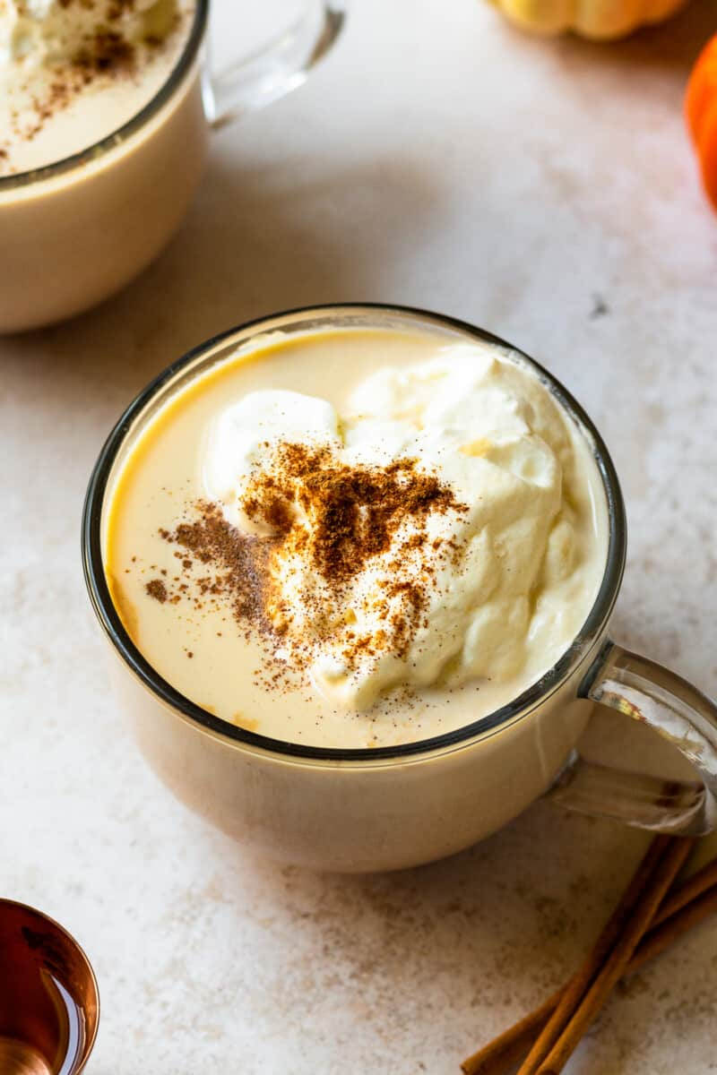 overhead hot pumpkin cocktail in mug with whipped cream