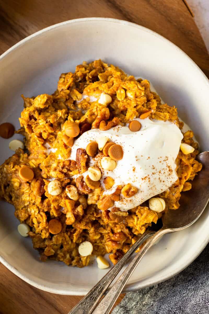 up close pumpkin oatmeal in white bowl