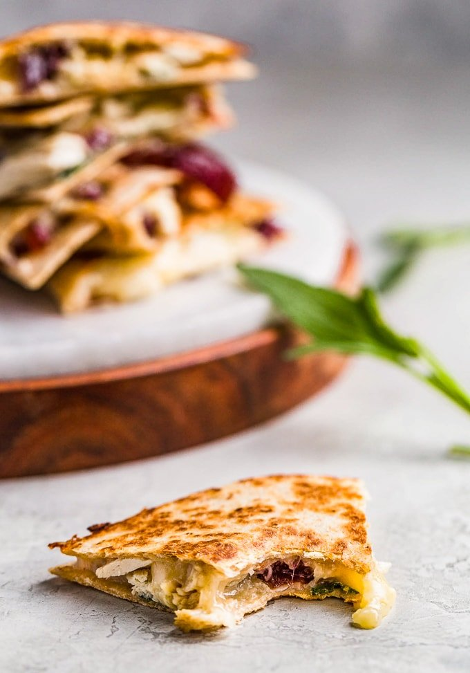 Thanksgiving quesadilla filled with turkey, cheese, sage, and cranberry sauce.