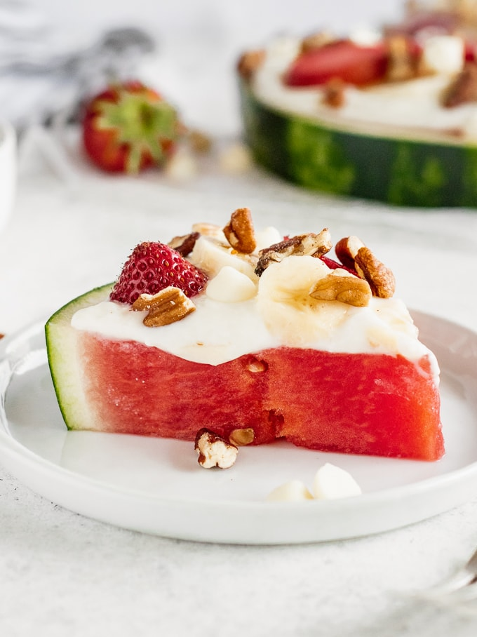 Slice of watermelon topped with low-fat cheesecake sauce