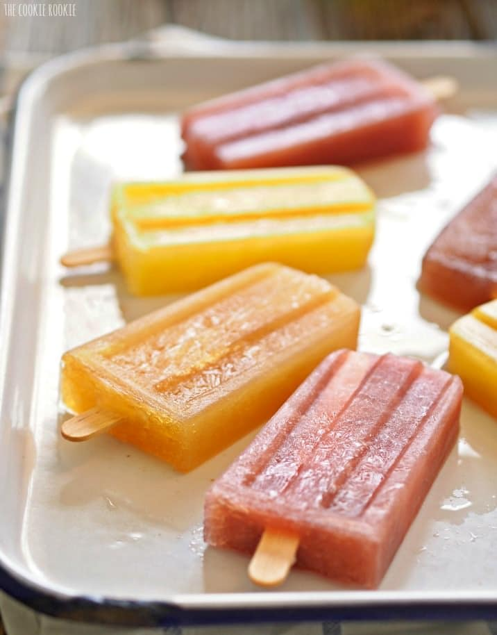 Mimosa Popsicles in Orange, Strawberry, Apple Cider, Blueberry, and Pineapple! So fun and delicious. Mimosa Champagne Pops for adults!