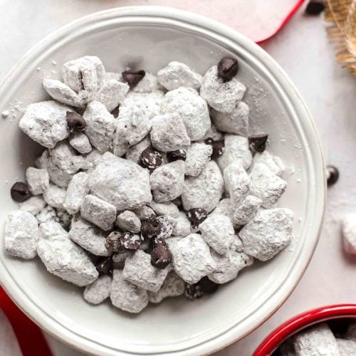Salted Caramel Puppy Chow is so addicting! If you're a fan of puppy chow snack mix, you're going to love this flavor combo. Chex cereal topped with caramel, chocolate, and powdered sugar. YUM!