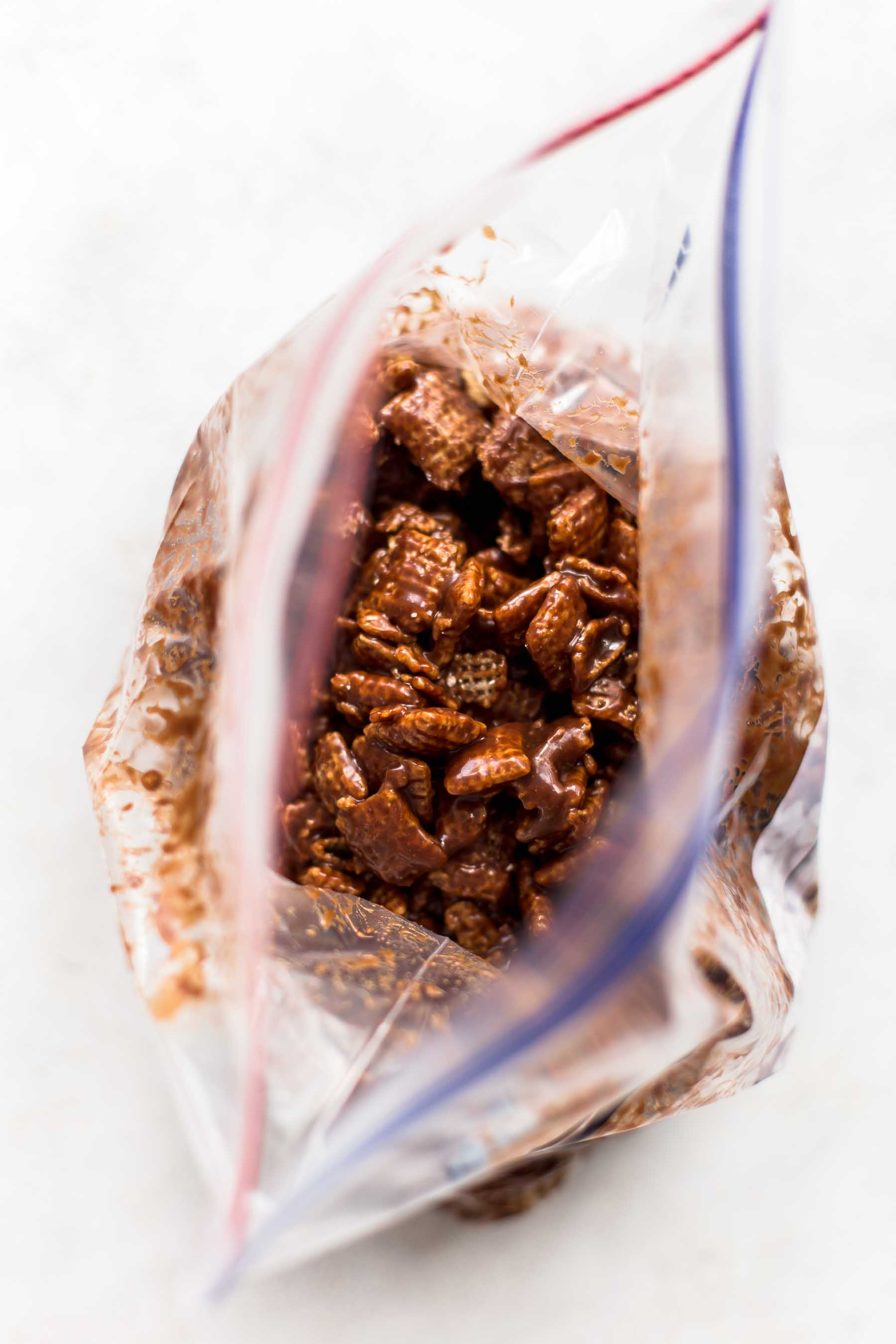chocolate coated chex cereal in a ziploc bag