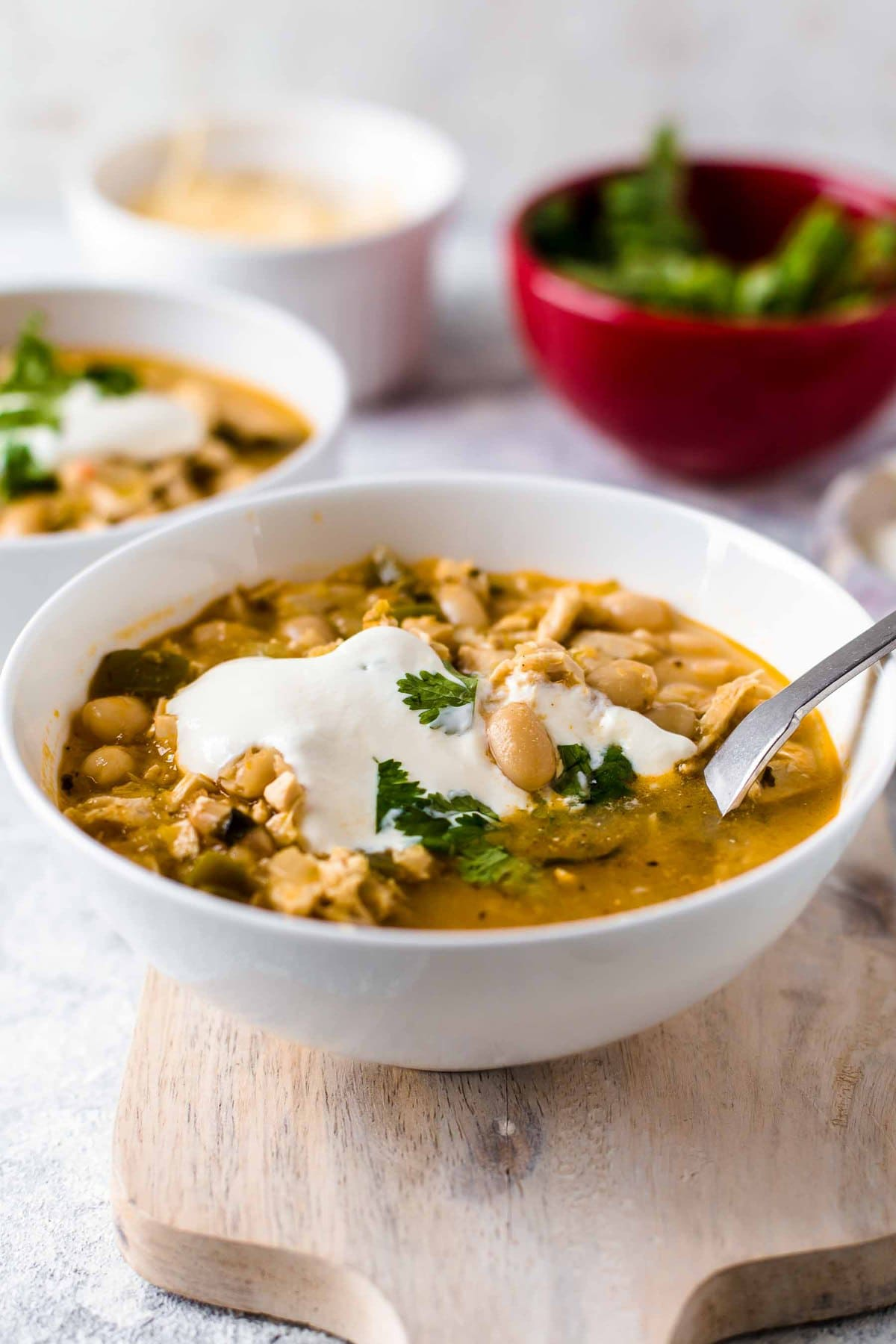 a bowl of chili made with chicken and white beans