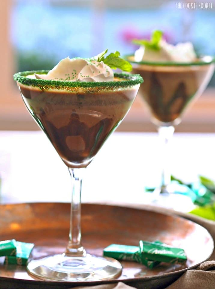 close up view of chocolatey cocktail with green-sprinkled rim