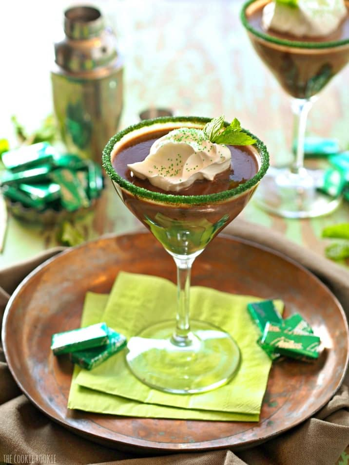 cocktail on a plate with green napkins and andes mints