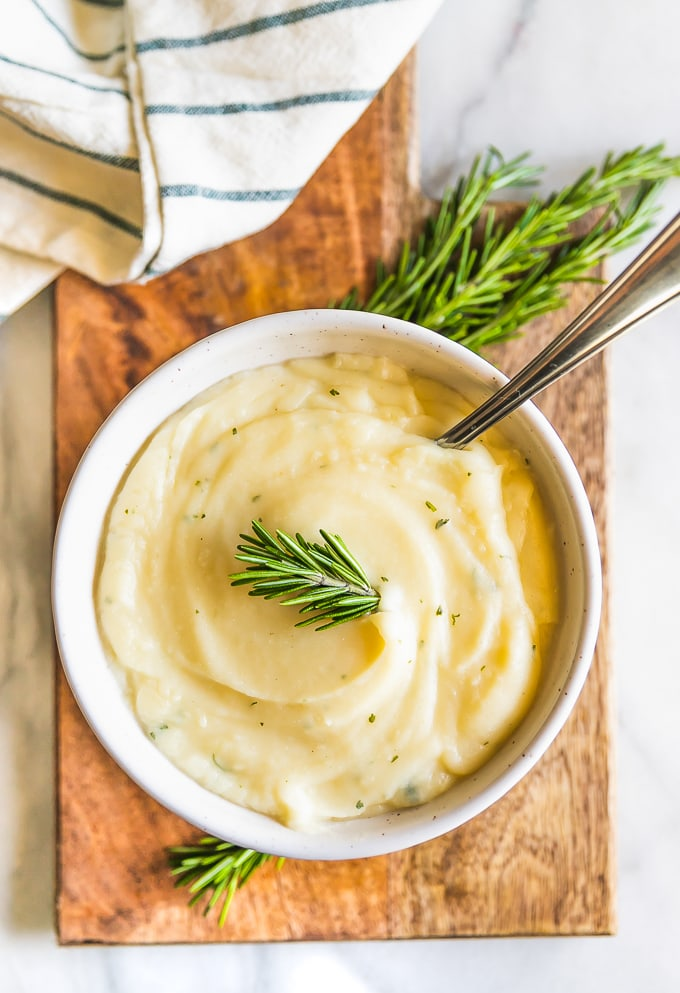 overhead picture of mashed cauliflower with rosemary and garlic