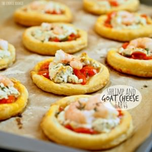 Shrimp and goat cheese tarts on a wooden board