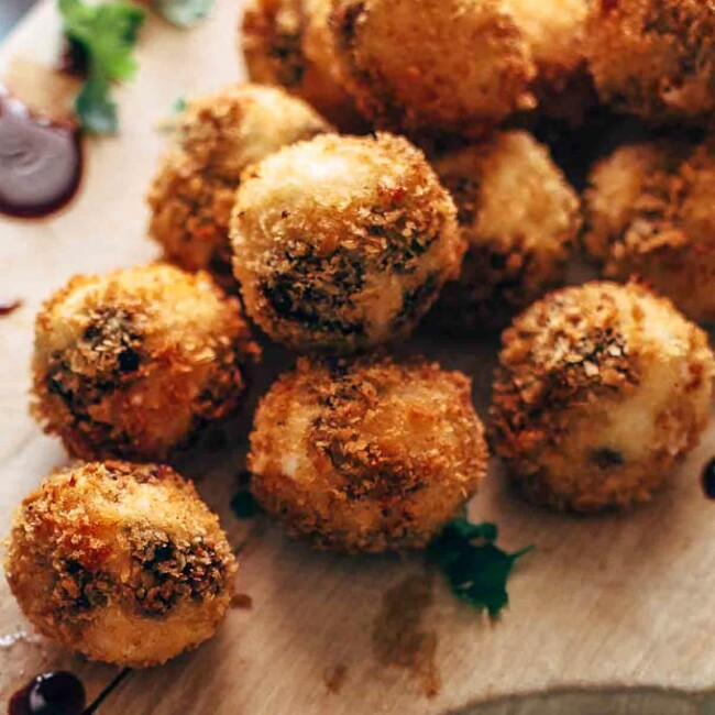 Fried Goat Cheese Balls are the perfect New Year's Eve appetizer! These goat cheese poppers are stuffed with dried cherries and pecans and then deep fried into a crispy little snack. It's definitely my favorite goat cheese appetizer!
