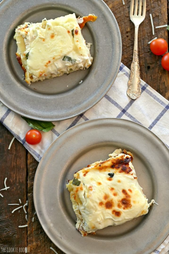 Creamy White Chicken Caprese Lasagna stuffed with mozzarella, cream cheese, artichokes, sundried tomatoes, and basil. SO delicious! The perfect comfort food!   The Cookie Rookie