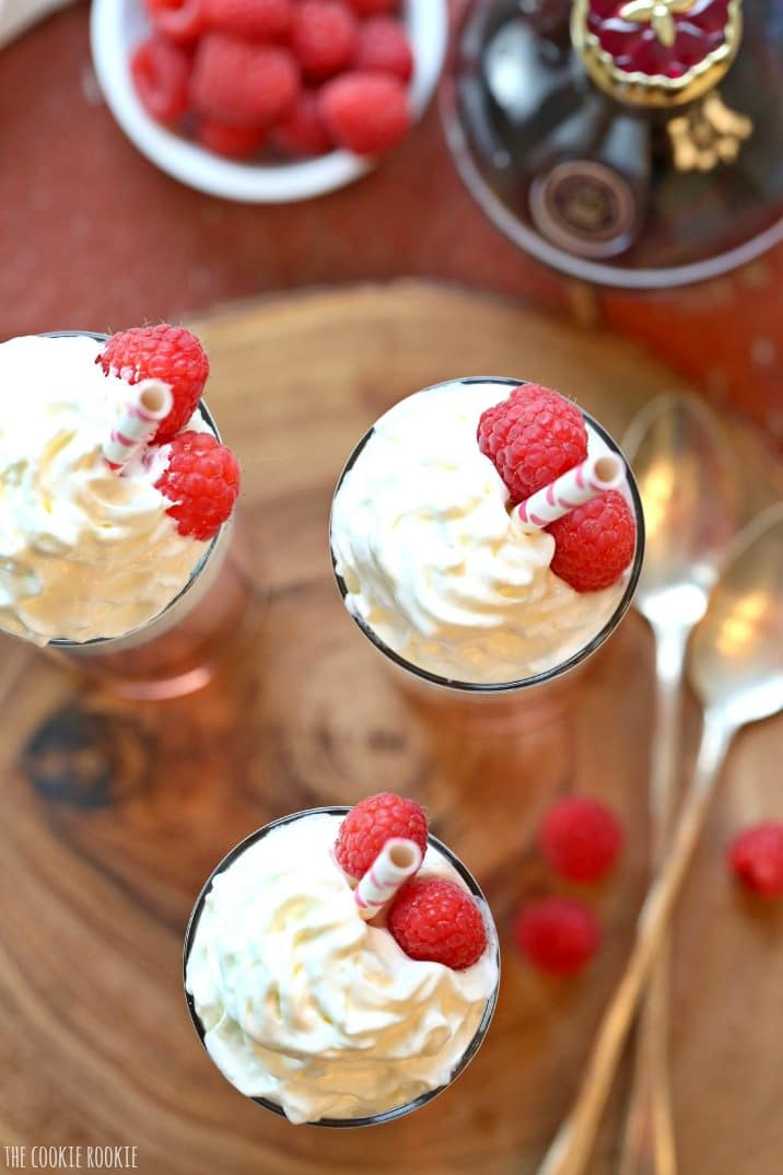 top view of drinks with whipped cream and raspberries