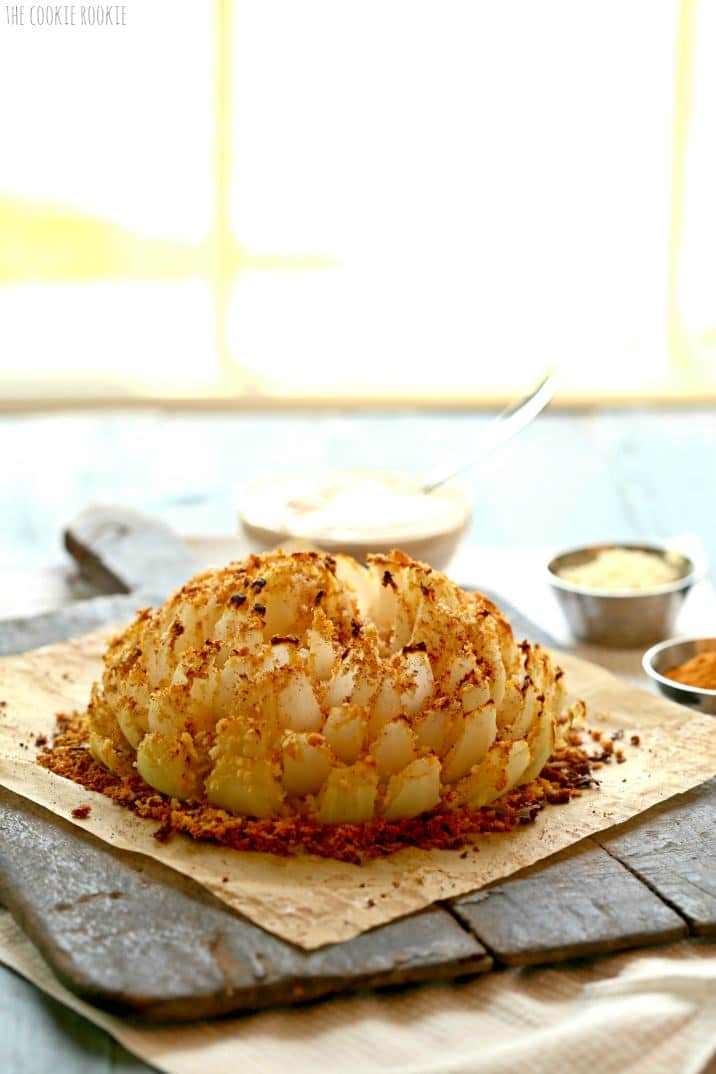 A Blooming Onion on a wood serving platter