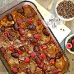 baking dish filled with nutella french toast and a lot of berries