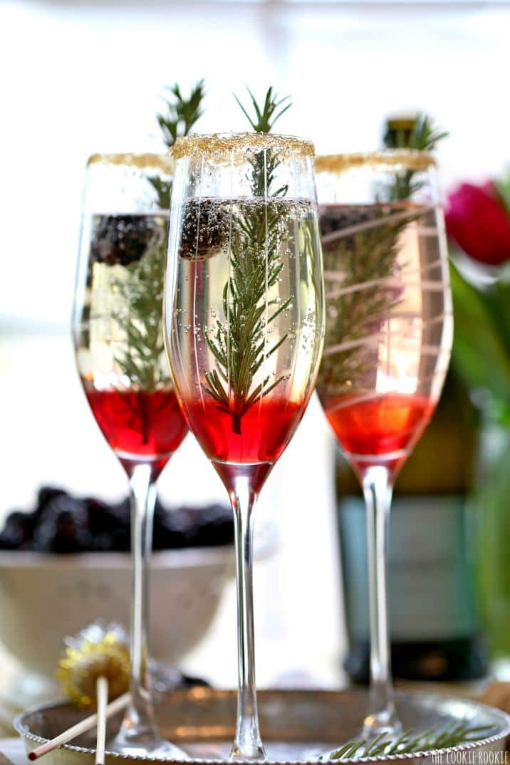 Blackberry Ombre Sparkler!! Made with Blackberry Simple Syrup, Champagne, and Rosemary. Perfect for Christmas and Valentine's Day! | The Cookie Rookie